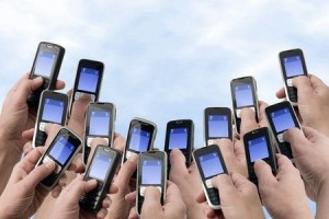 Multiple people texting on mobile phones